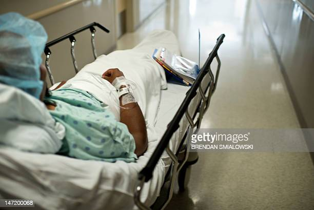 A donor is wheeled to an operating room for a kidney transplant at Johns Hopkins Hospital June 26 2012 in Baltimore Maryland Doctors from Johns...
