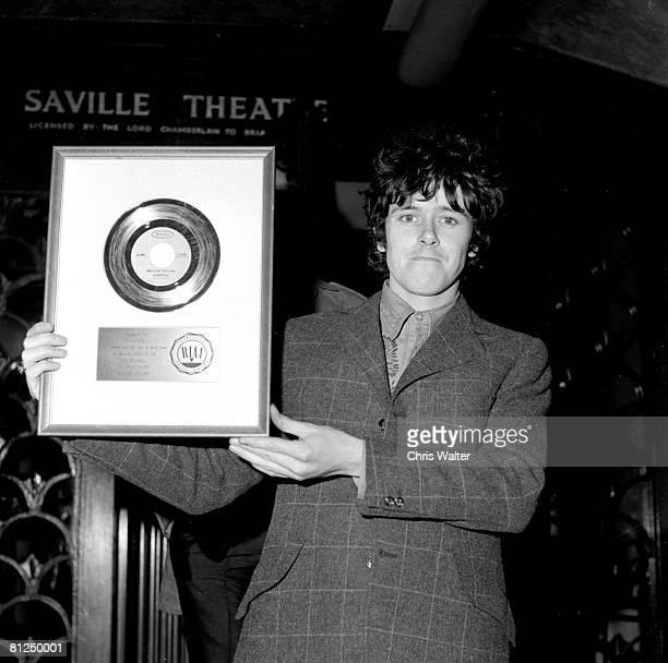 Donovan 1967 with 'Sunshine Superman' US Gold Record Chris Walter