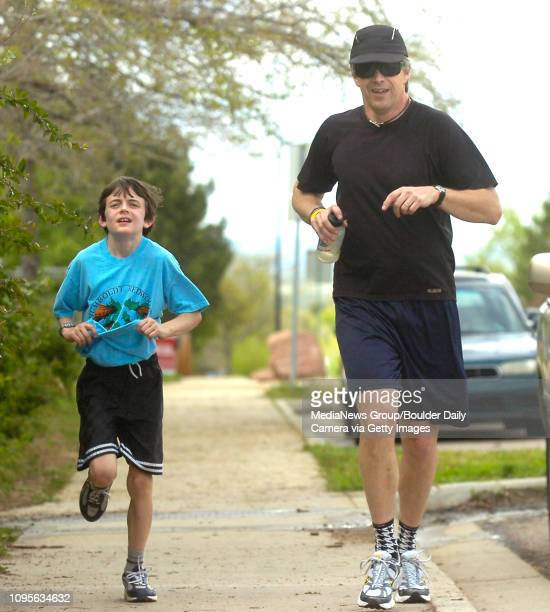 Donovan Allen a 5th grader at Mesa Elementary School in Boulder makes his way up a hill while running with 5th grade teach Rico Kellogg on Wednesday...
