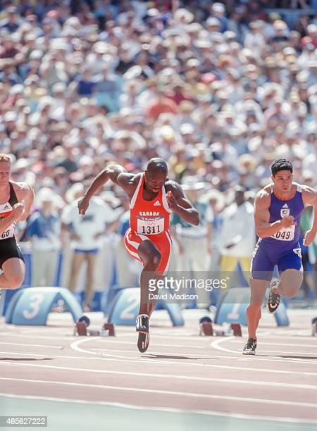 Donovan Bailey of Canada runs a preliminary round of the Men's 100 meter event of the 2000 Summer Olympics track and field competition on September...