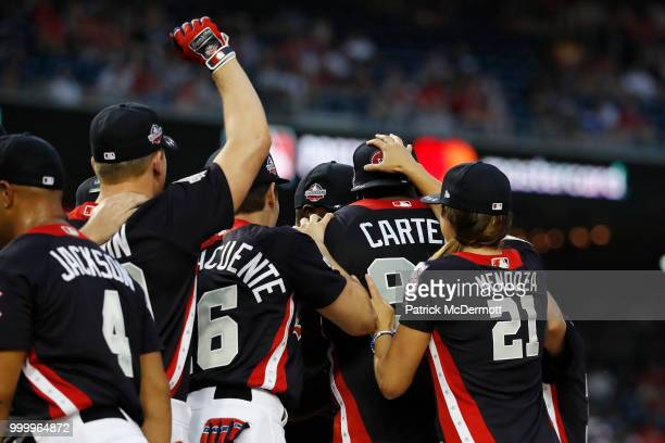 Donovan Carter celebrates with his teamates during the AllStar and Legends Celebrity Softball Game at Nationals Park on July 15 2018 in Washington DC