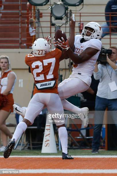 Donovan Duvernay of the Texas Longhorns breaks up a pass in the endzone intended for Devin Duvernay of the Texas Longhorns in the first half during...