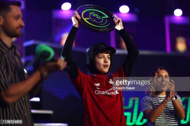 Donovan 'F2Tekkz' Hunt of Liverpool celebrates with the trophy after he wins the ePremier League Finals 2019 at Gfinity Arena on March 29 2019 in...