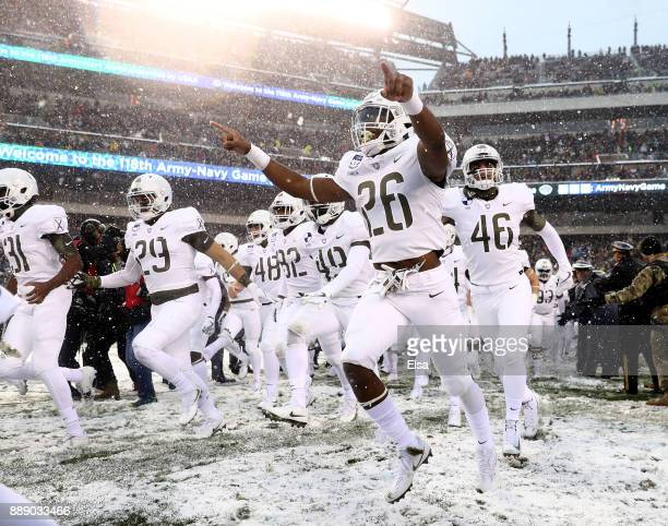 Donovan Franklin of the Army Black Knights and the rest of his teammates run out on the field before the game against the Navy Midshipmen on December...