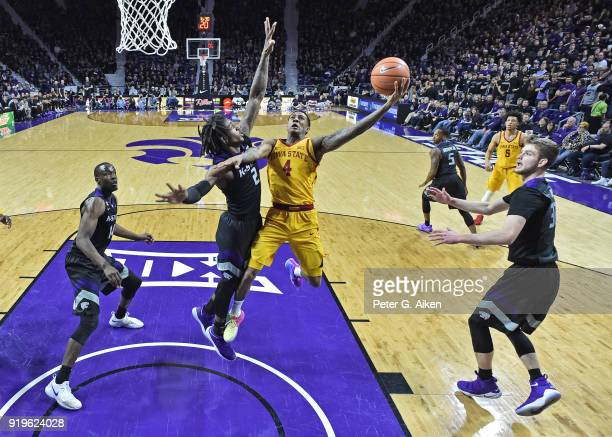 Donovan Jackson of the Iowa State Cyclones drives to the basket against Cartier Diarra of the Kansas State Wildcats during the second half on...