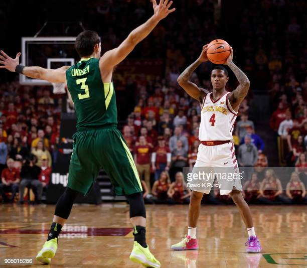 Donovan Jackson of the Iowa State Cyclones looks to pass the ball as Jake Lindsey of the Baylor Bears blocks in the first half of play at Hilton...