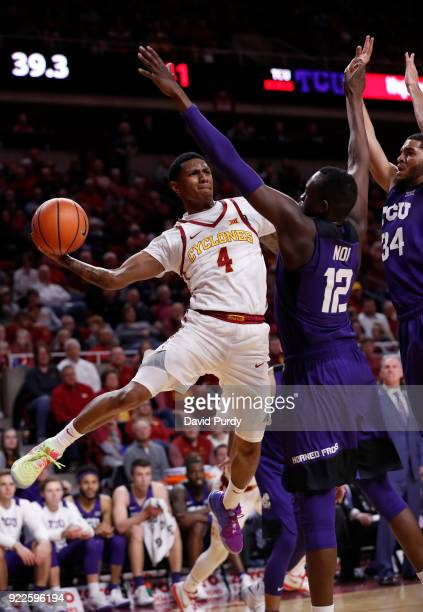 Donovan Jackson of the Iowa State Cyclones passes the ball as Kouat Noi and Kenrich Williams of the TCU Horned Frogs defend in the first half of play...