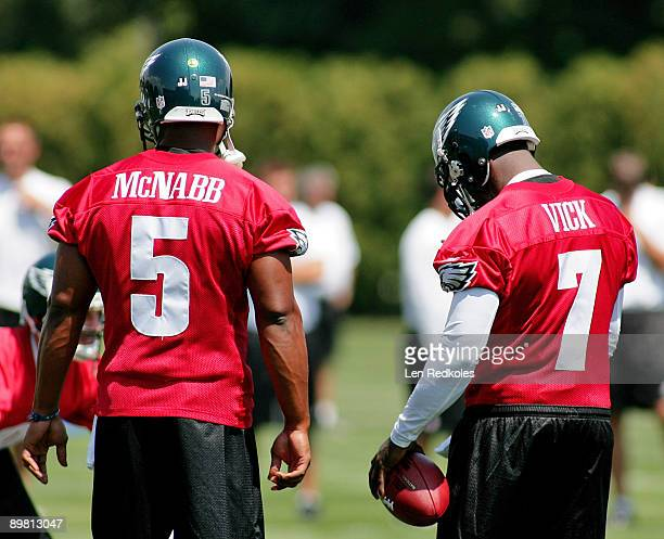 Donovan McNabb and Michael Vick look on during a workout at the NovaCare Complex on August 15 2009 in Philadelphia Pennsylvania