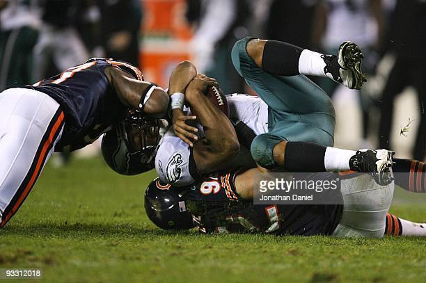 Donovan McNabb of the Philadelphia Eagles is sacked by Hunter Hillenmeyer and Mark Anderson of the Chicago Bears at Soldier Field on November 22 2009...