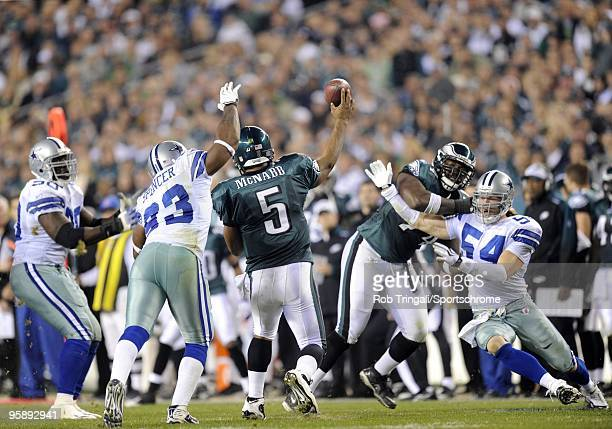Donovan McNabb of the Philadelphia Eagles passes as Bobby Carpenter and Anthony Spencer of the Dallas Cowboys defend at Lincoln Financial Field on...
