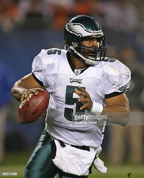 Donovan McNabb of the Philadelphia Eagles rolls out to pass against the Chicago Bears at Soldier Field on November 22 2009 in Chicago Illinois The...