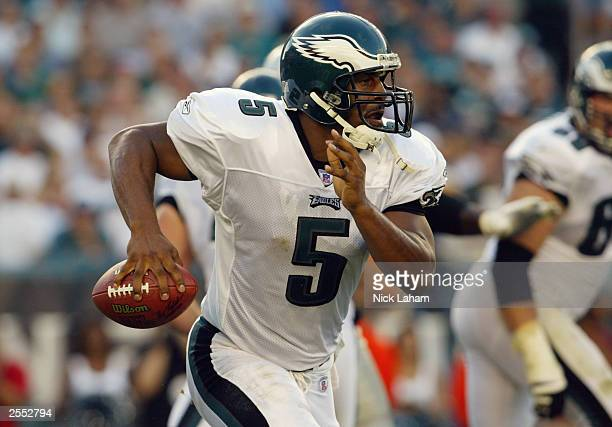 Donovan McNabb of the Philadelphia Eagles scrambles against the New England Patriots on September 14 2003 at Lincoln Financial Field in Philadelphia...