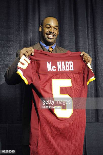 Donovan McNabb of the Washington Redskins displays his new jersey during a press conference on April 6 2010 at Redskin Park in Ashburn Virginia