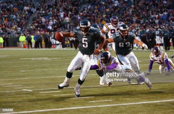 Donovan McNabb quarterback for the Philadelphia Eagles runs for a touchdown versus the Minnesota Vikings in their game at Veterans Stadium in...