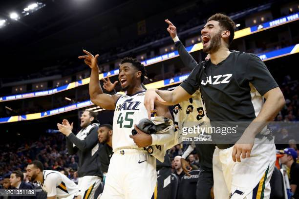 Donovan Mitchell and Georges Niang of the Utah Jazz celebrate on the bench during their game against the Golden State Warriors at Chase Center on...