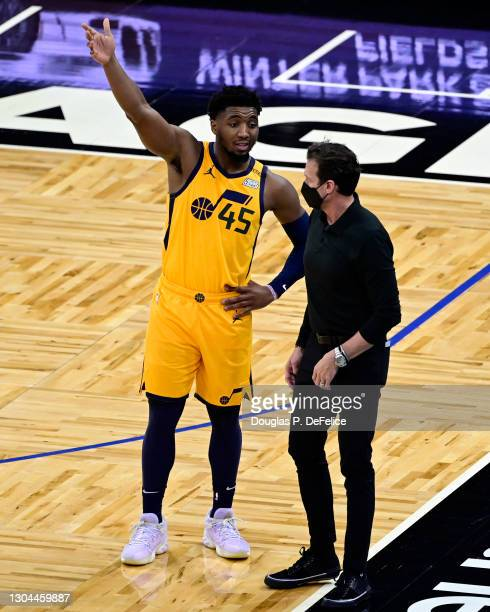 Donovan Mitchell and Head coach Quin Snyder of the Utah Jazz interact during the fourth quarter against the Orlando Magic at Amway Center on February...