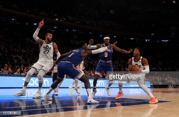Donovan Mitchell and Rudy Gobert of the Utah Jazz in action against RJ Barrett and Bobby Portis of the New York Knicks at Madison Square Garden on...