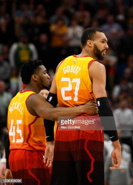 Donovan Mitchell holds teammate Rudy Gobert of the Utah Jazz during a game against the Toronto Raptors at Vivint Smart Home Arena on March 9 2020 in...