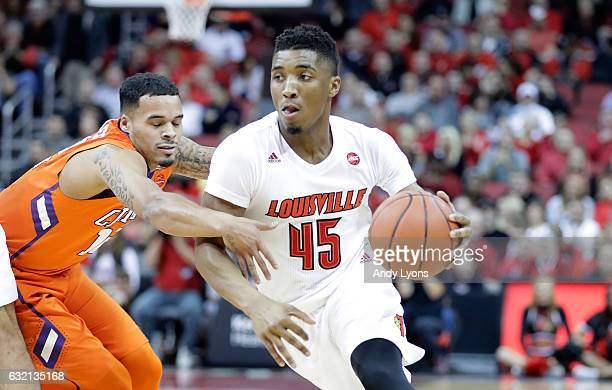 Donovan Mitchell of the Louisville Cardinals dribbles the ball against the Clemson Tigers at KFC YUM Center on January 19 2017 in Louisville Kentucky