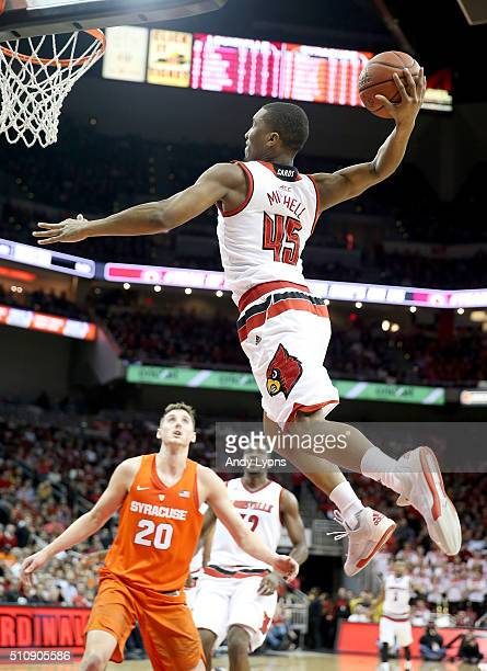 Donovan Mitchell of the Louisville Cardinals dunks the ball during the game against the Syracuse Orange at KFC YUM Center on February 17 2016 in...