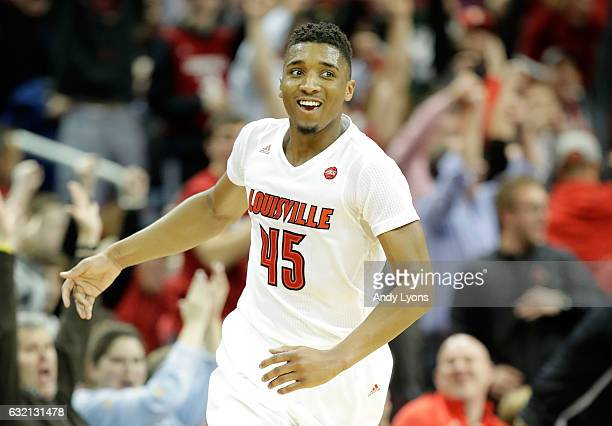 Donovan Mitchell of the Louisville Cardinals reacts after making a three point shot to end the first half against the Clemson Tigers at KFC YUM...