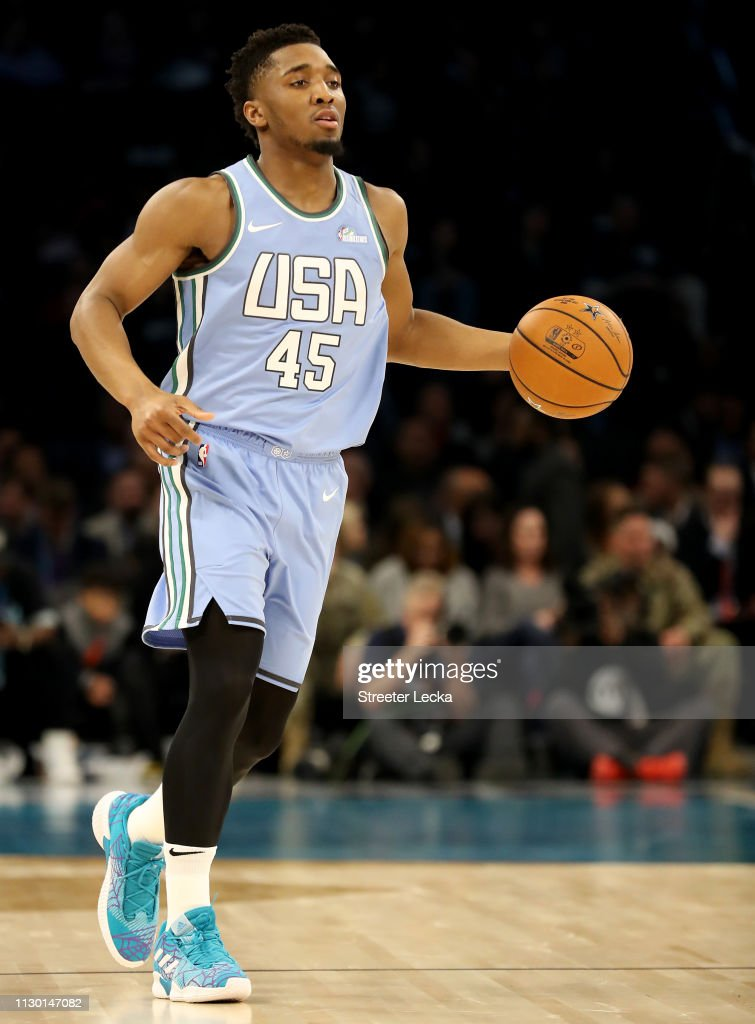 save off 0eb07 47dfc Donovan Mitchell of the U.S. Team dribbles down court during ...