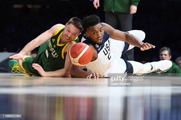 Donovan Mitchell of the USA and Matthew Dellavadova of Australia compete for the ball during the International Basketball Friendly match between the...