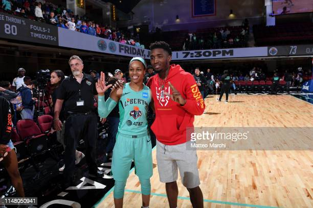 Donovan Mitchell of the Utah Jazz and Asia Durr of the New York Liberty pose for a photo after a game between the Los Angeles Sparks and the New York...