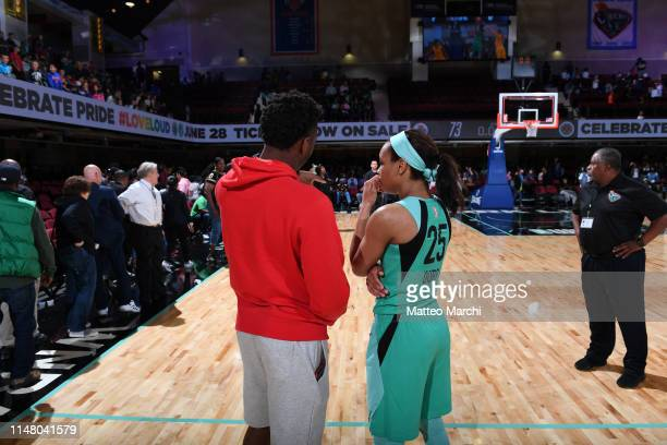 Donovan Mitchell of the Utah Jazz and Asia Durr of the New York Liberty talk after a game between the Los Angeles Sparks and the New York Liberty on...