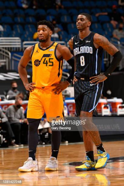 Donovan Mitchell of the Utah Jazz and Dwayne Bacon of the Orlando Magic looks on during the game on February 27, 2021 at Amway Center in Orlando,...
