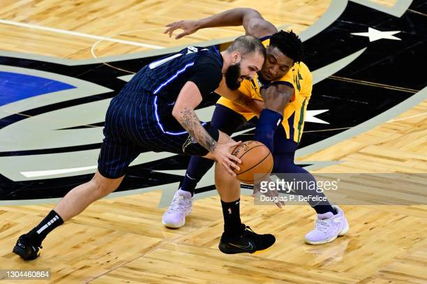 Donovan Mitchell of the Utah Jazz and Evan Fournier of the Orlando Magic fight for the ball during the first quarter at Amway Center on February 27,...