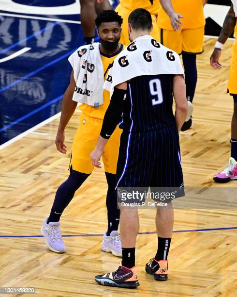 Donovan Mitchell of the Utah Jazz and Nikola Vucevic of the Orlando Magic interact after the game at Amway Center on February 27, 2021 in Orlando,...