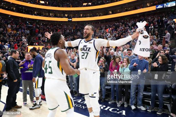 Donovan Mitchell of the Utah Jazz and Rudy Gobert of the Utah Jazz celebrate after a win against the Dallas Mavericks on January 25, 2020 at...