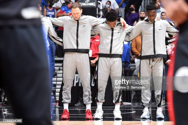 Donovan Mitchell of the Utah Jazz and teammates stand for the national anthem before the game against the LA Clippers during Round 2, Game 6 of the...