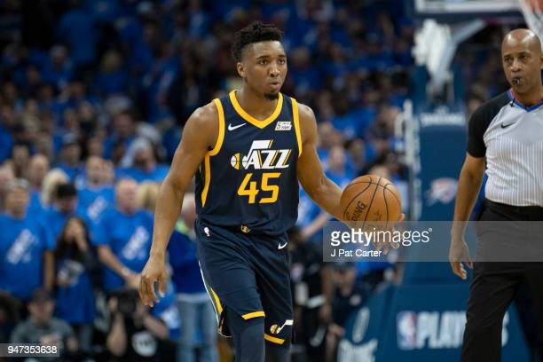 Donovan Mitchell of the Utah Jazz b brings the ball down court against the Oklahoma City Thunder during the first half of Game One of the Western...