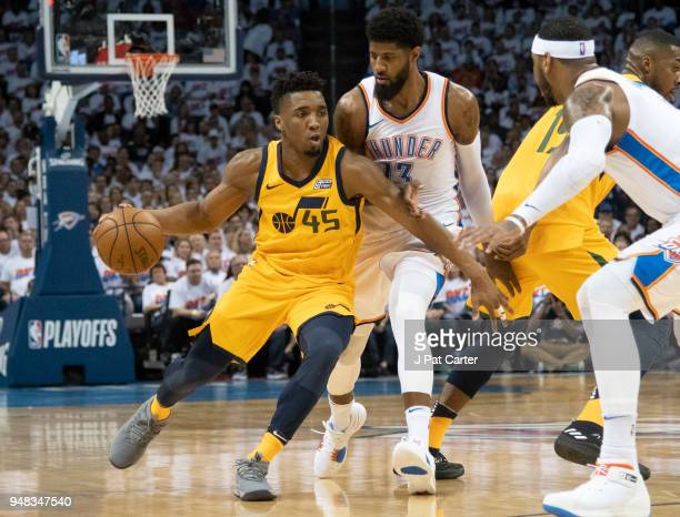 Donovan Mitchell of the Utah Jazz battles his way around Paul George of the Oklahoma City Thunder during the first half of Game 2 of the Western...