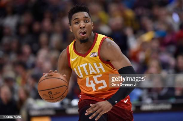 Donovan Mitchell of the Utah Jazz brings the ball up court against the San Antonio Spurs in the first half of a NBA game at Vivint Smart Home Arena...