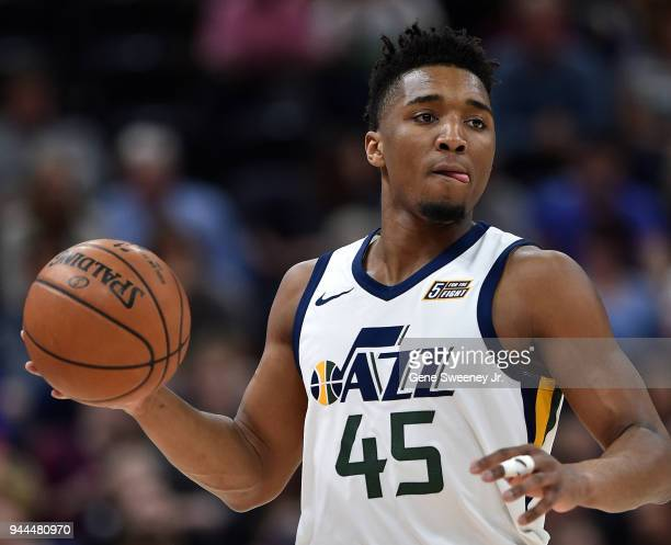 Donovan Mitchell of the Utah Jazz brings the ball up court against the Golden State Warriors in the first half of a game at Vivint Smart Home Arena...