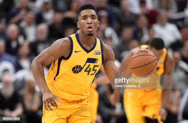 Donovan Mitchell of the Utah Jazz brings the ball up court during their game against the Houston Rockets at Vivint Smart Home Arena on December 7...