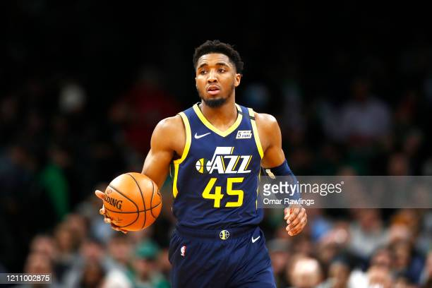 Donovan Mitchell of the Utah Jazz brings the ball up court during the third quarter of the game against the Boston Celtics at TD Garden on March 06,...