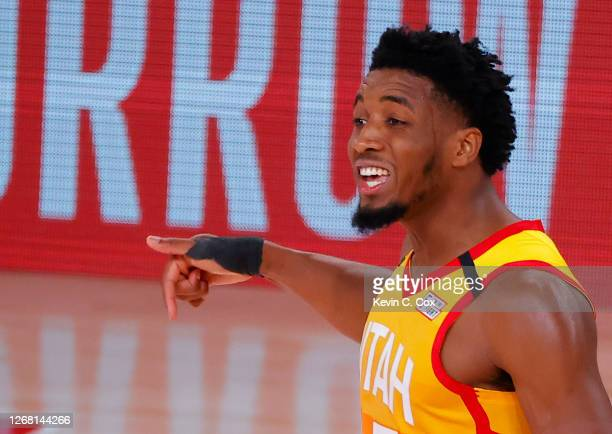 Donovan Mitchell of the Utah Jazz celebrates a three point basket against the Denver Nuggets during the fourth quarter in Game Four of the Western...