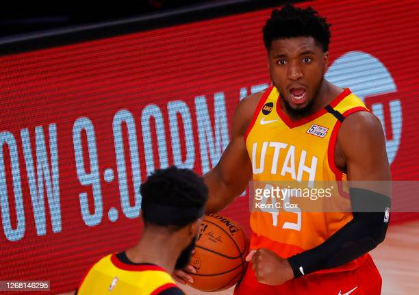 Donovan Mitchell of the Utah Jazz celebrates a win against the Denver Nuggets following Game Four of the Western Conference First Round during the...