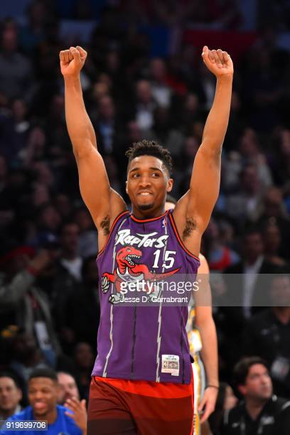 Donovan Mitchell of the Utah Jazz celebrates after recreating Vince Carter's classic dunk during the Verizon Slam Dunk Contest during State Farm...