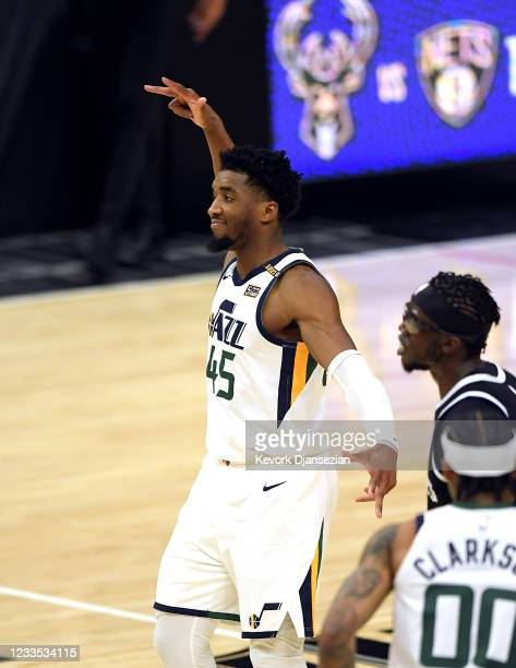 Donovan Mitchell of the Utah Jazz celebrates after scoring a three-point basket against Reggie Jackson of the Los Angeles Clippers during the first...
