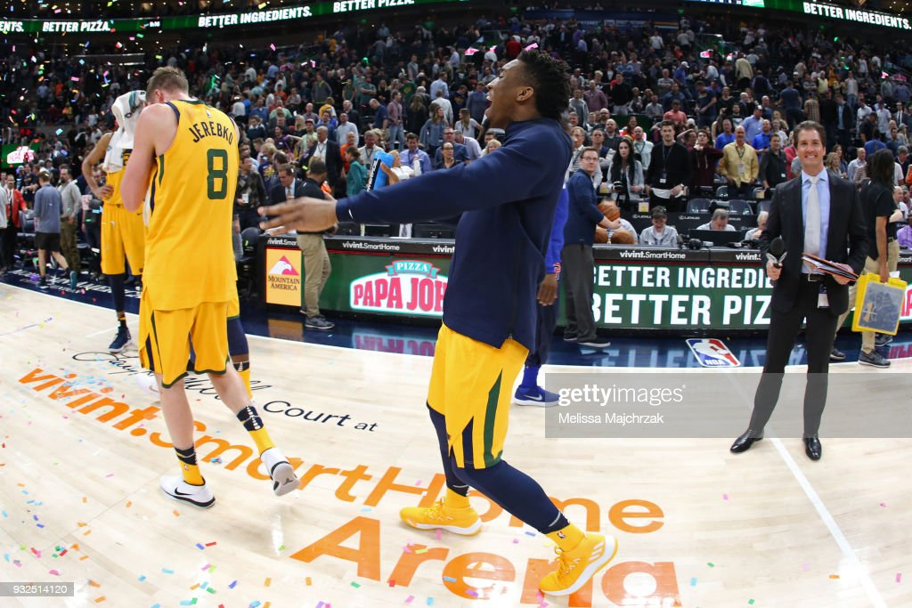 Donovan Mitchell #45 of the Utah Jazz celebrates with Jonas Jerebko #8 after defeating the Detroit Pistons on March 13, 2018 at vivint.SmartHome Arena in Salt Lake City, Utah.