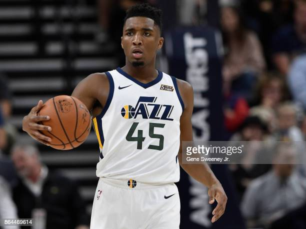 Donovan Mitchell of the Utah Jazz controls the ball against the Denver Nuggets at Vivint Smart Home Arena on October 18 2017 in Salt Lake City Utah...