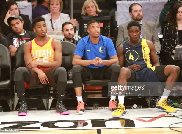 Donovan Mitchell of the Utah Jazz Dennis Smith Jr #1 of the Dallas Mavericks and Victor Oladipo of the Indiana Pacers sit on the bench during The...