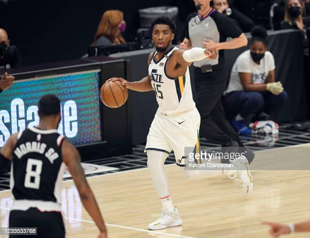 Donovan Mitchell of the Utah Jazz dribbles the ball against Los Angeles Clippers during the first half in Game Six of the Western Conference...