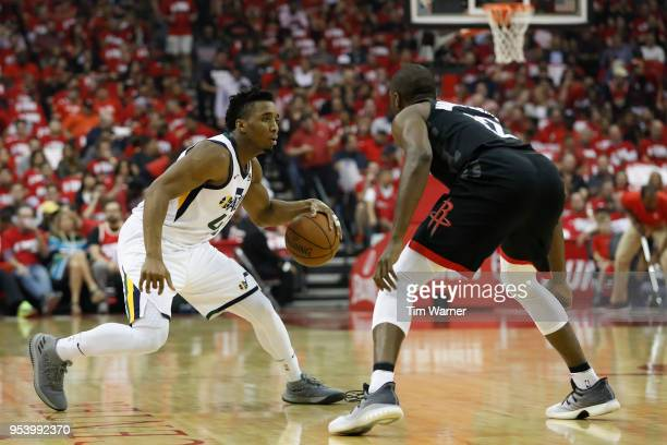 Donovan Mitchell of the Utah Jazz dribbles the ball defended by Luc Mbah a Moute of the Houston Rockets in the first half during Game Two of the...