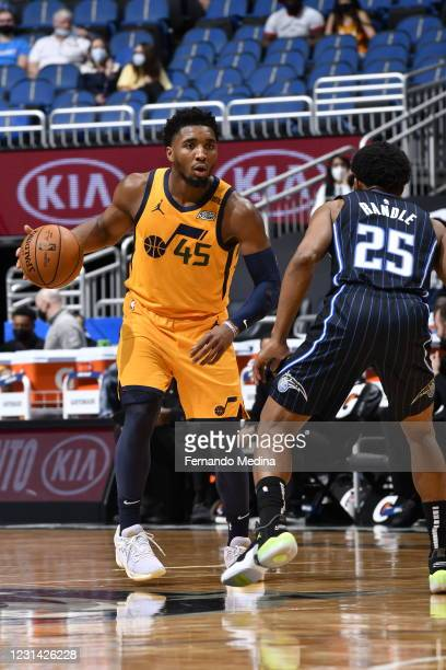 Donovan Mitchell of the Utah Jazz dribbles the ball during the game against the Orlando Magic on February 27, 2021 at Amway Center in Orlando,...